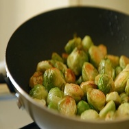 Roast brussels sprouts with ham Stock Footage