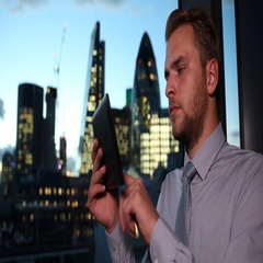 Good Looking Businessman Using Digital Tablet Working Online London Skyline City Stock Footage