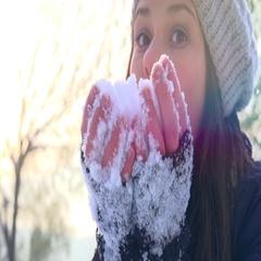 Winter girl. Winter girl blowing snow. Teenage Girl having fun in winter park Stock Footage