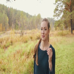 Beatiful girl with red-head walks in the autumn forest Stock Footage