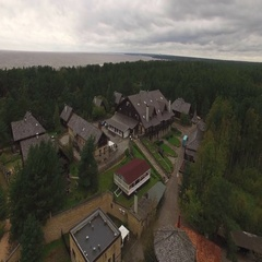 Village hotel complex Old Mill aerial shot Stock Footage