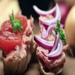 Man puts pate on the bread. Man puts pate with the silver knife on a slice of Stock Footage