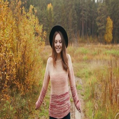 Beautiful girl in a black hat looks at the camera and smiles Stock Footage