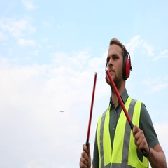 Airport Transportation Crew Man Park Marshaller Guide Airplane Passing Overhead Stock Footage
