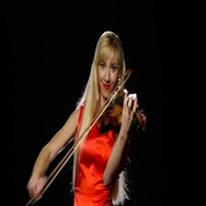 Girl plays the fiddle. Studio. Close-up. Black background Stock Footage