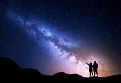 Milky Way with people on the mountain. Landscape with night sky with stars Stock Photos