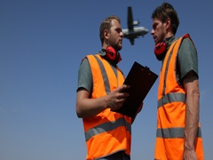 Airport Staff Ground Service Men Collaboration Analyzing Plans Airplane Flying Stock Footage