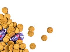 Bunch of spread Pepernoten cookies and chocolate mice Stock Photos