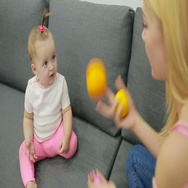 Mom and baby playing on the couch Stock Footage