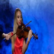 Girl professional fiddler playing the viola. Studio. Smoke Stock Footage