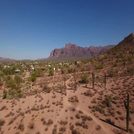 Reverse Flyover Aerial Establishing Shot of Superstition Mountain in Arizona  	 Stock Footage