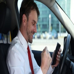 Positive Business Male Analyzing Digital Tablet Success Result in Vehicle Inside Stock Footage