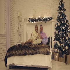 Happy young couple on New Year's night lying on the sofa Stock Footage