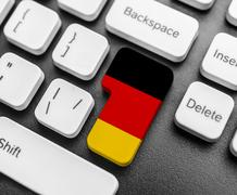 Enter key button with Flag of Germany. Stock Photos