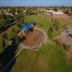 Aerial Establishing Shot of Typical Arizona Residential Neighborhood Playground	 Stock Footage