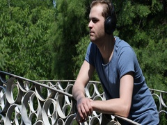 Attractive Young Boy Standing with Headphones Listening to Music Park Summer Day Stock Footage