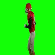 Athlete runs in protective gear with helmet and gloves. Green screen Stock Footage