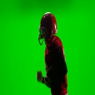 The player runs with the ball in his hand and throws it. Green screen Stock Footage