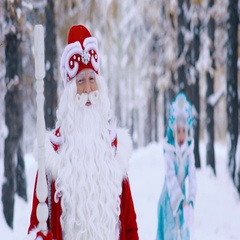 Snow Maiden in the background throwing the snow up to the air, Father Frost in Stock Footage