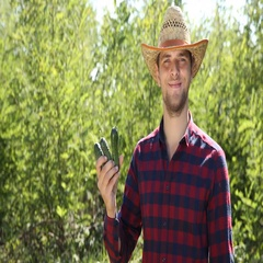 Confident Farmer Man Holding Fresh Cucumbers Delicious Vegan Look Camera Smiling Stock Footage