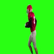 The athlete runs with the ball in his hands. Sow motion, green screen Stock Footage