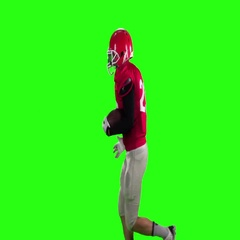Football runs in spats and a red helmet. Slow motion, green screen Stock Footage