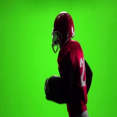 Athlete in red uniform with a ball. Slow motion. Side view. Green screen Stock Footage