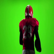 Football player touches the ball in his hand. Slow motion. Green screen Stock Footage