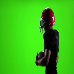 Football player running with the ball and a red helmet. Slow motion Stock Footage