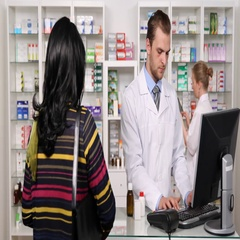Kindly Pharmacist Man Talking with Customer Who Pays Drug in Pharmaceutical Shop Stock Footage