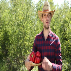 Young Farmer Worker Holding Red Pepper and Talking to Camera Bio Farming Concept Stock Footage