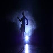 Girl dancing movements of salsa, rumba, silhouette. Dark background, blue Stock Footage