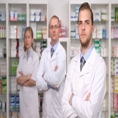 Group of Pharmacist People Looking Camera in Drugstore Interior Pharmacy Store Stock Footage