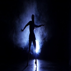 Woman dancing rumba in studio, silhouette. Dark background, blue backlight Stock Footage