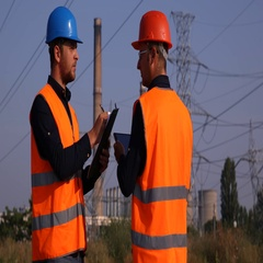 Two Worker Men Working and Talking in Front of Power Plant Electricity Generator Stock Footage