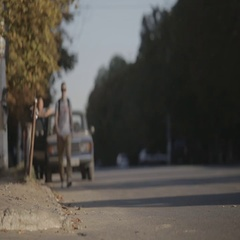 Dnepropetrovsk 2015. A young man goes to the road lengthwise and catches a taxi Stock Footage