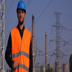 Pleased Workman Looking Camera and Showing OK Sign Near Electric Generator Area Stock Footage