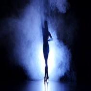 Woman dancing samba in studio, silhouette. Dark background, blue backlight Stock Footage