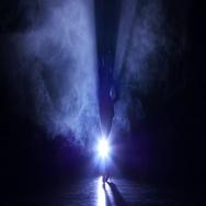 Graceful girl dancing in studio cha-cha-cha, silhouette. Dark background, blue Stock Footage