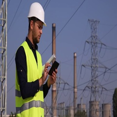 Young Electrician Expert Man Working on Touchpad Device at Transformers Station Stock Footage