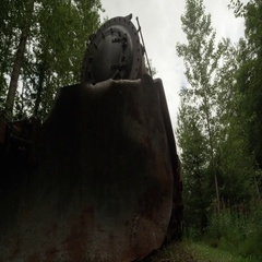 Panning view of train engine in the Alaska forest Stock Footage