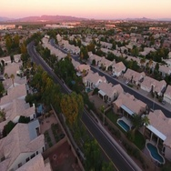 Reverse Angle Aerial Morning Flyover View of Typical Arizona Neighborhood   Stock Footage