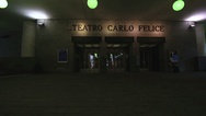 Some ghosts are walking outside the theater Carlo Felice in Genoa in Italy Stock Footage