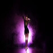 Dancer in studio with purple lighting, a dark background Stock Footage