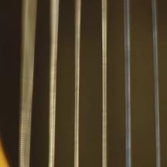 ECU Guitar strings being strummed Stock Footage