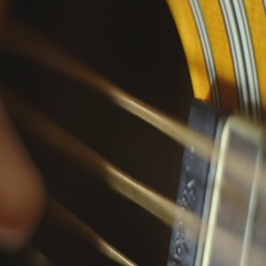 Macro shot of hand picking and strumming guitar Stock Footage