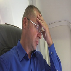 Businessman Manager Looking Sad and Having Headache Pain Onboard Aircraft Travel Stock Footage