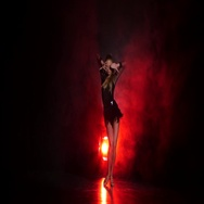 Dancer in studio with red illumination on a dark background Stock Footage