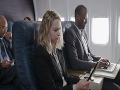 Man and woman using technology in aircraft business class 4K Stock Footage