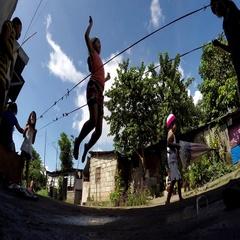 Children playing Chinese garter jump rope along railway Stock Footage